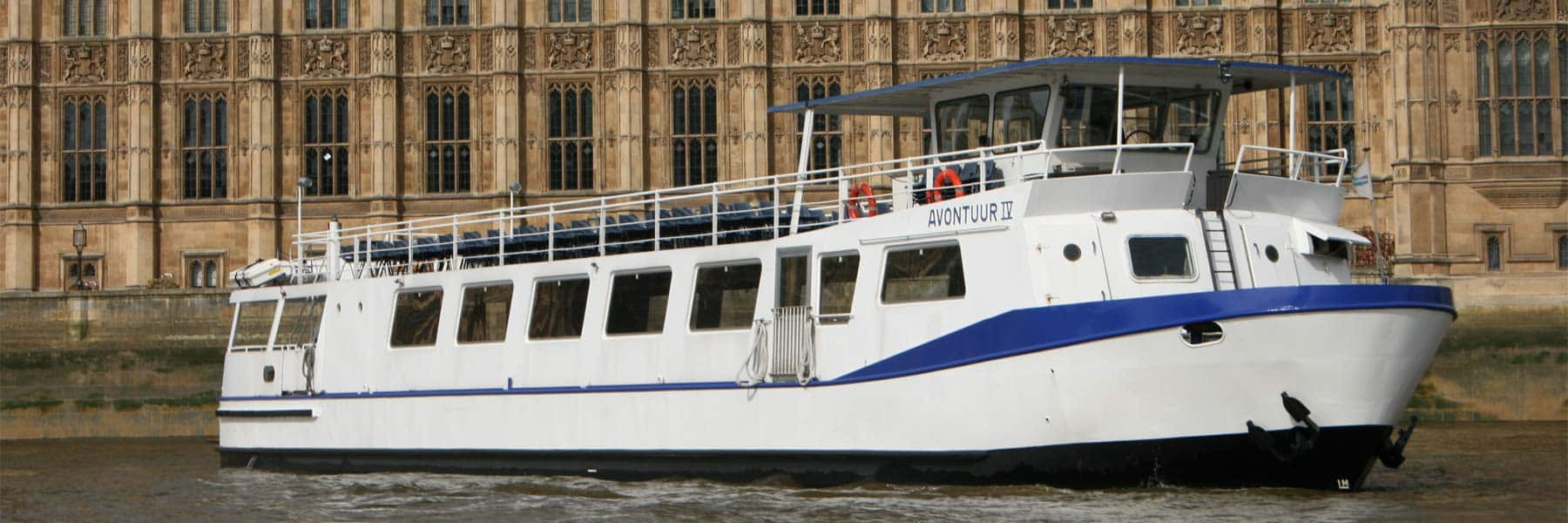 M.V Avontuur IV passing the New Palace of Westminster (Houses of Parliament)