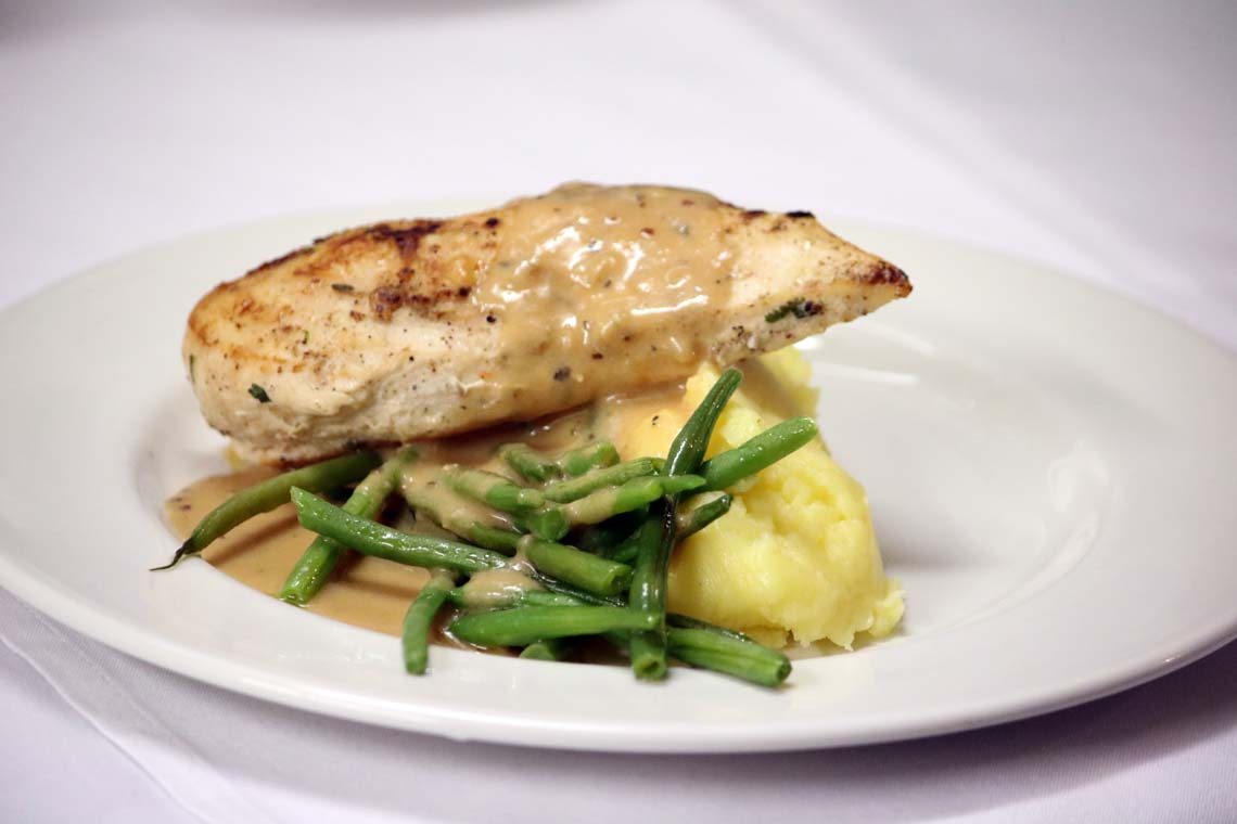 Grilled Suffolk Chicken Breast with Green Peppercorn Sauce, French Beans & Truffle Mash